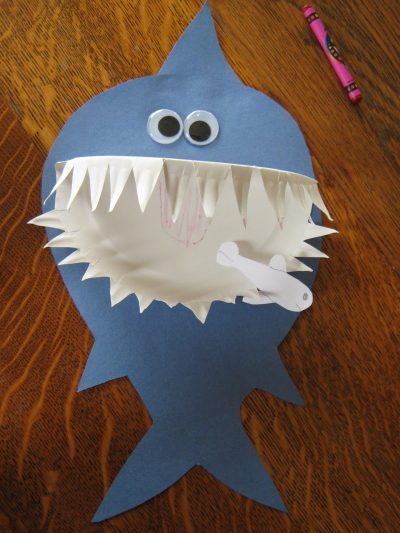 this adorable shark craft is made from a paper plate and blue paper a