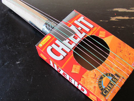 Recycled box guitar fun family crafts for Projects made out of recycled items