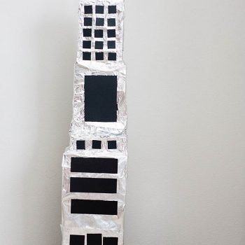 Cardboard Skyscraper and Parking Garage