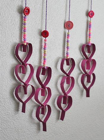 Cardboard Tube Dangling Hearts