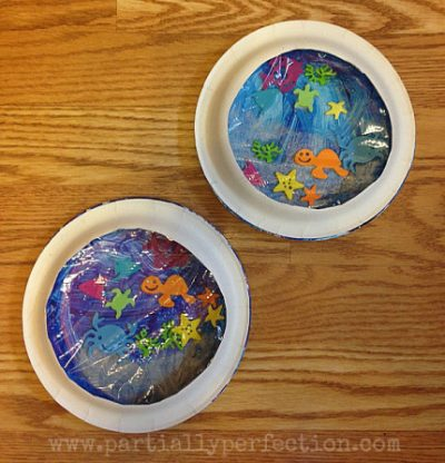 Create your own little saltwater world with this Ocean Aquarium Craft. It all starts with paper plates.