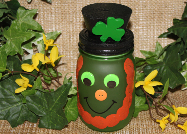 Light up St. Patrick's day with this cheeky little mason jar Leprechaun. He's sure to make you smile!