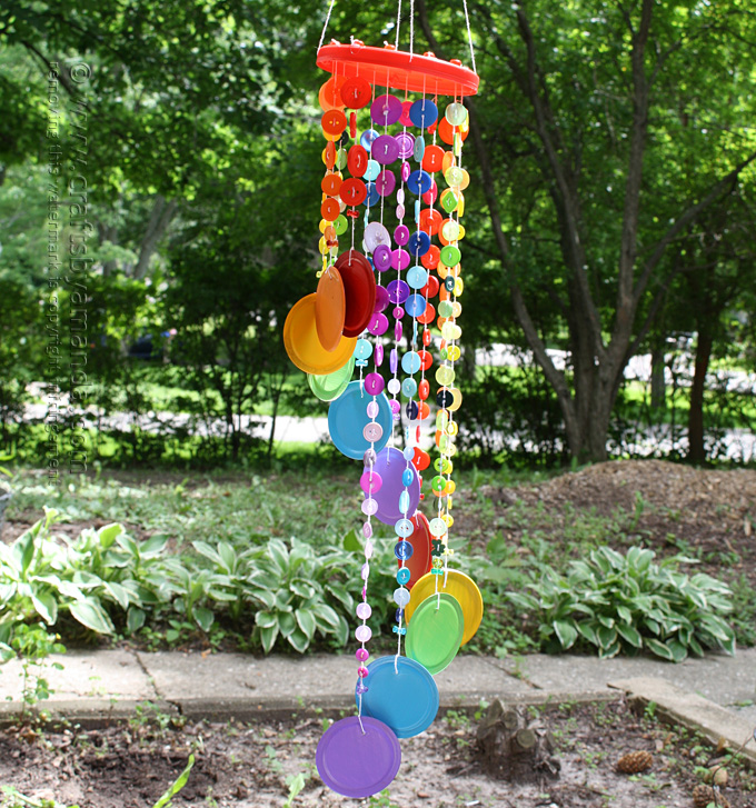 Make a colorful wind chime from recycled lids and buttons!
