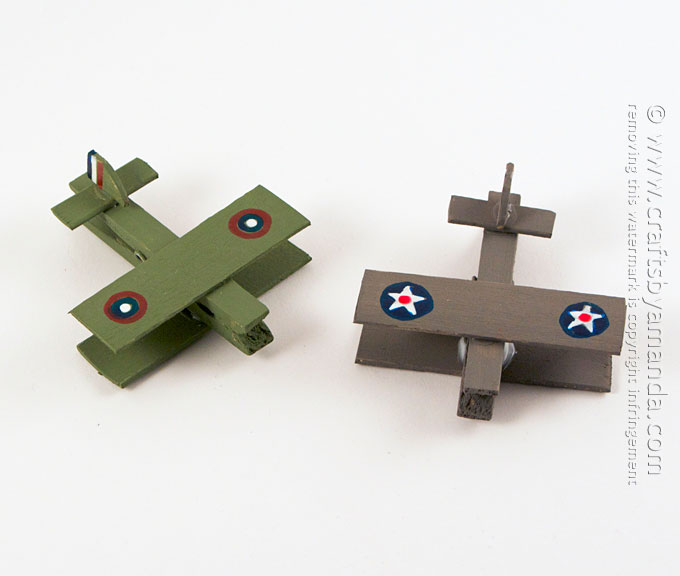 Show your support for our military by making these clothespin airplanes made to look like vintage war planes!