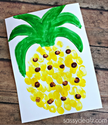 A child's fingerprints make a wonderful painted pineapple craft.