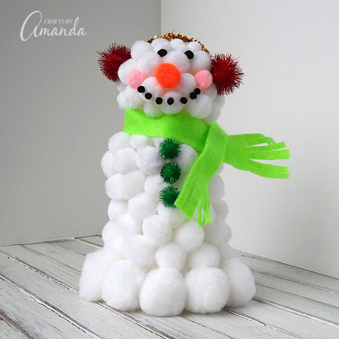 Create an adorable snowman from pom poms!