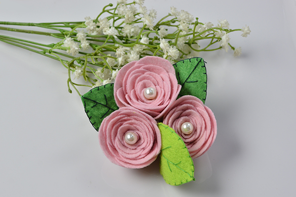 Felt rose corsage fun family crafts mothers day diy project how to make a pink felt rose flower brooch mightylinksfo