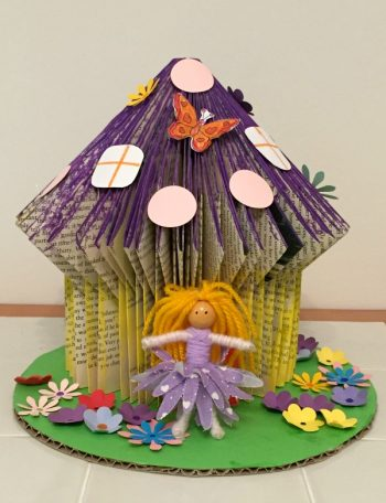 A book folded fairy house and fairy