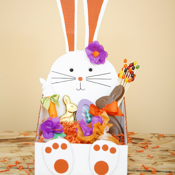 DIY bunny shaped Easter basket to make from a cardboard box.