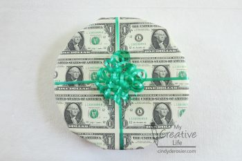 Make your gift even more memorable by wrapping it with dollar bills!