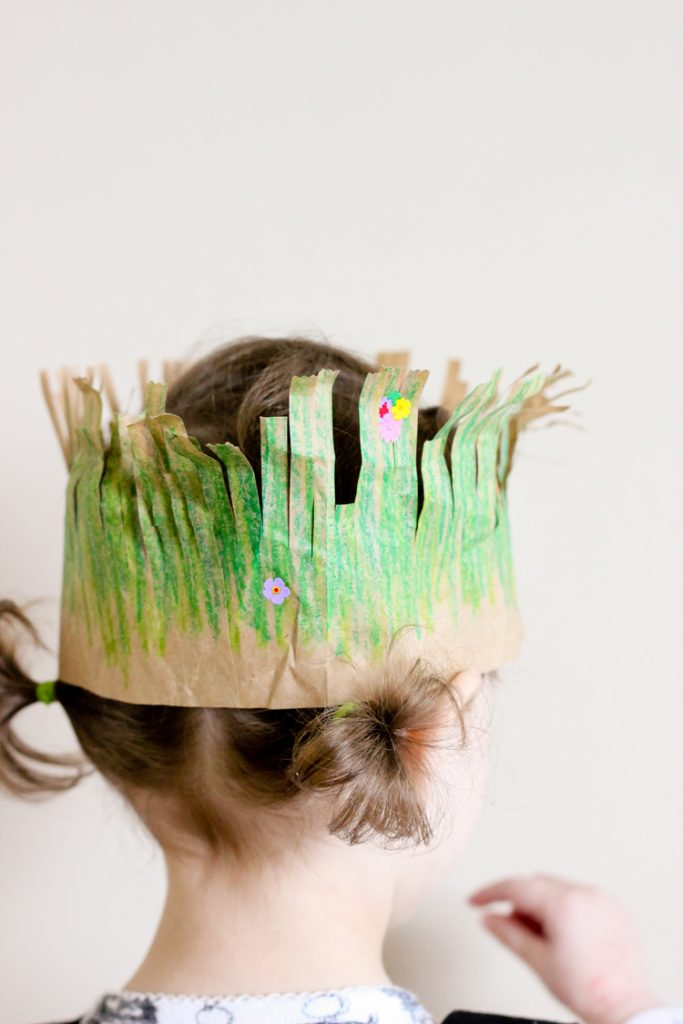 Turn a paper bag into a crown for Earth Day.