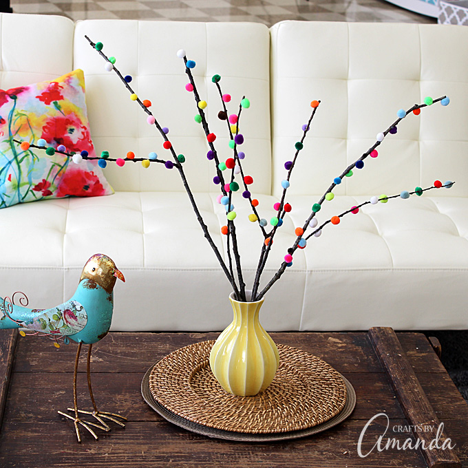 These colorful pom pom branches are a great touch for anywhere you need decorating!
