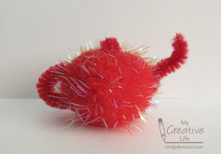 Create a cute little teapot using pom poms.