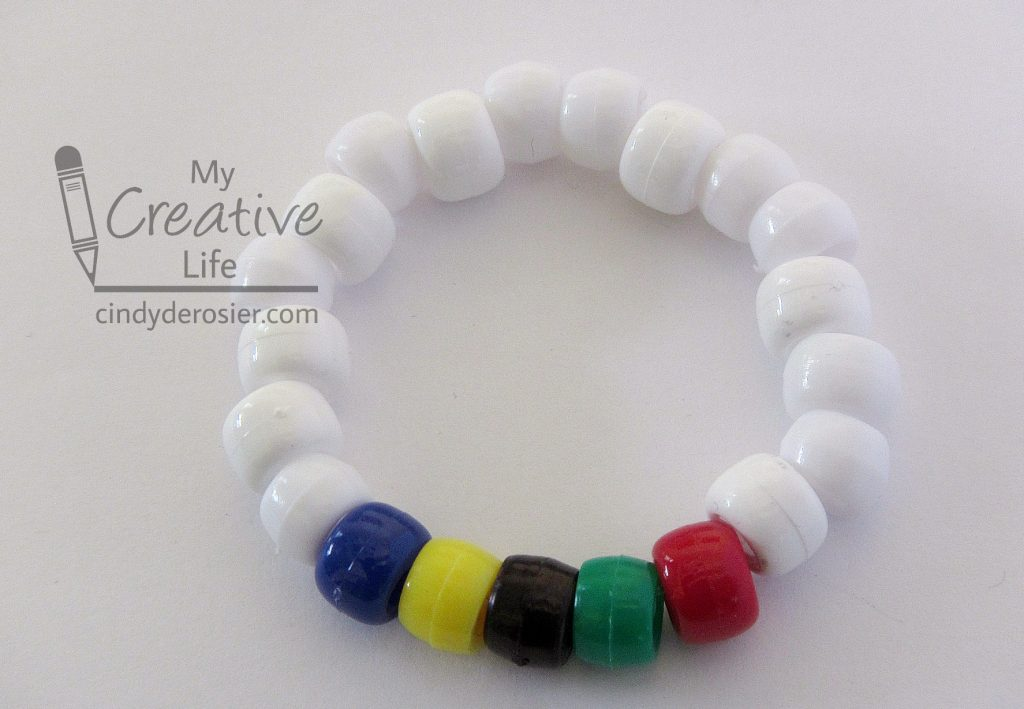 This bracelet is a fun activity for an Olympics-themed party.