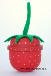 Turn an empty gumball machine container into a cute strawberry.