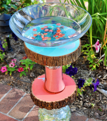 It's sure to be a hot summer and this Homemade Bird Bath is a really fun project to add some color and flair to any garden or backyard!