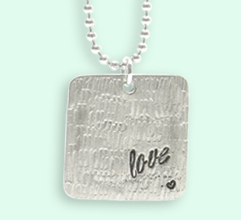 Metal stamped Love Pendant