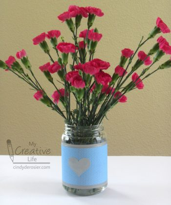 Turn an empty pickle jar into a pretty vase.