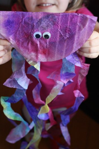 Adorable jellyfish made from coffee filters that kids can color themselves, a great preschool ocean themed craft!