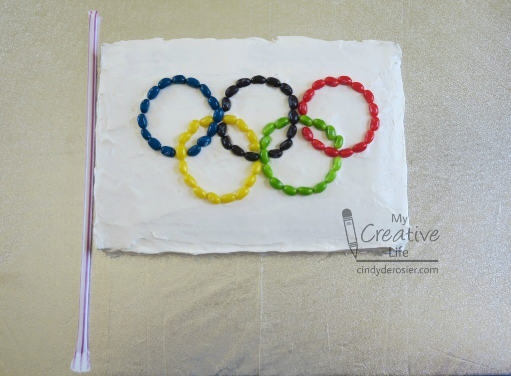 This Olympic Flag cake is so easy to make.