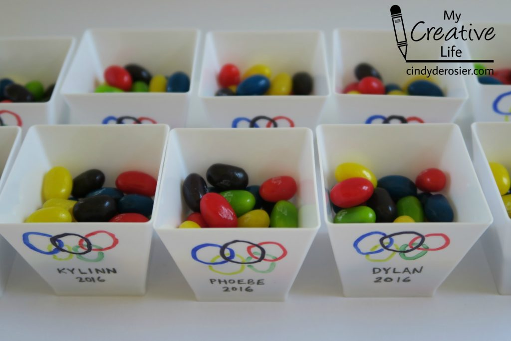 Make souvenir treat cups for an Olympic-themed party.