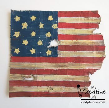 Turn cardboard into a replica of the flag that inspired Francis Scott Key to write The Star Spangled Banner.