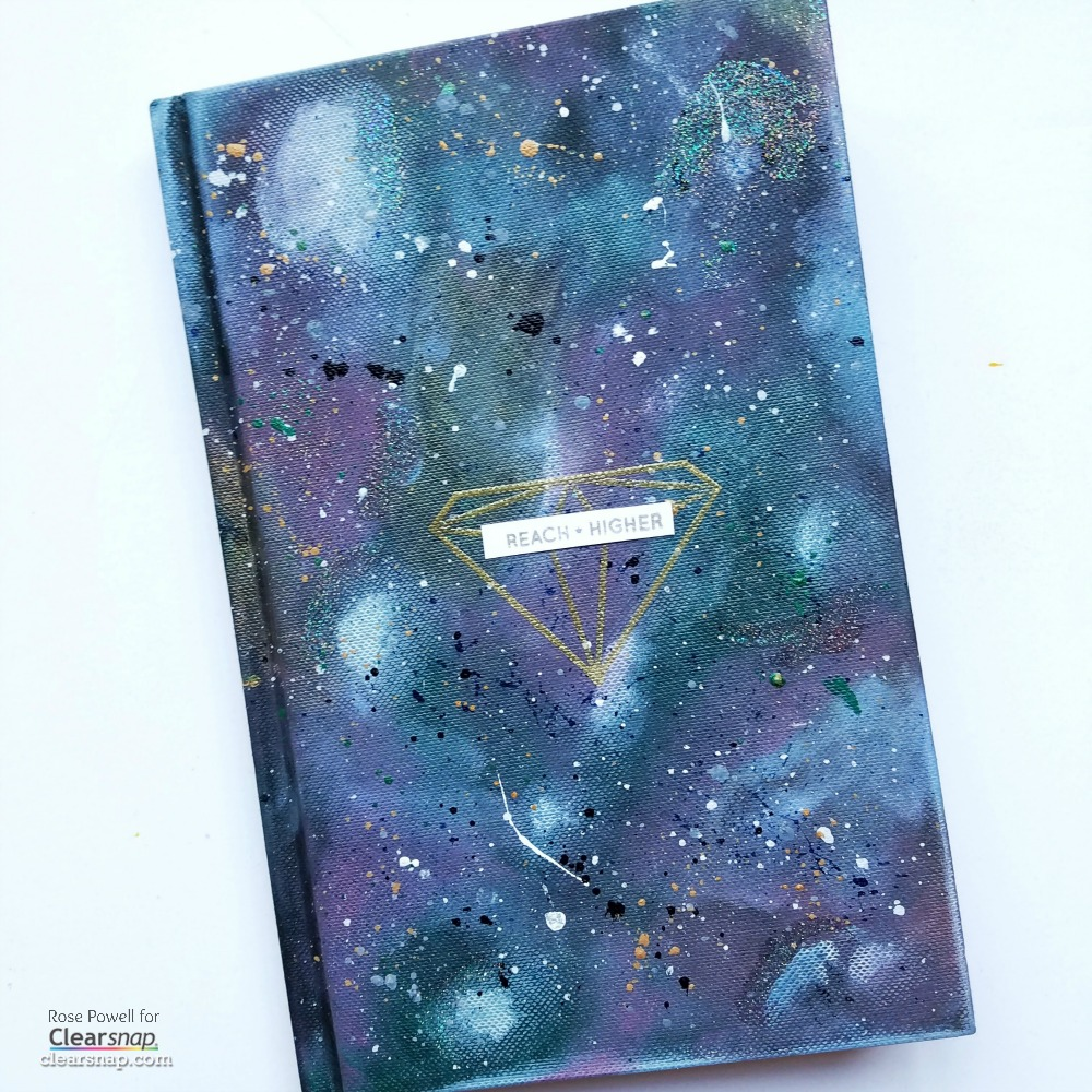 Create a galaxy-inspired cover for a plain journal.