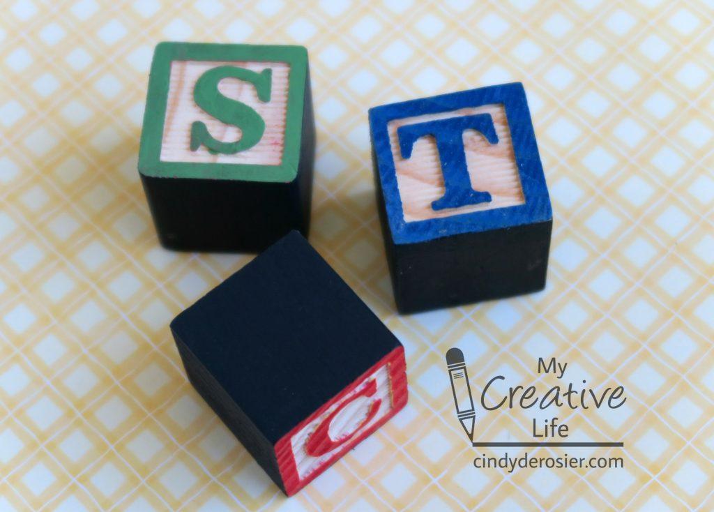 Repurpose baby blocks into monogram refrigerator magnets!