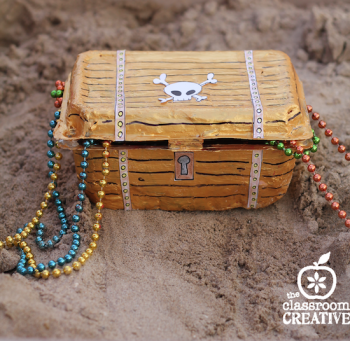 This treasure chest is made from a recycled strawberry container!