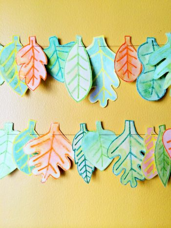 Decorate for fall with a watercolor leaf garland.