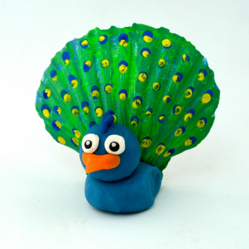Playdough and a shell make an awesome peacock!