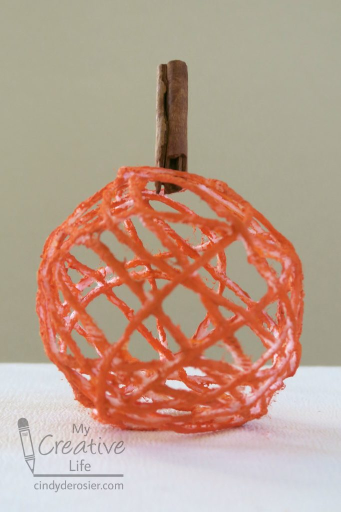 Decorate for fall with a yarn pumpkin.