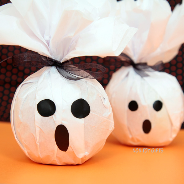 Make these fun and healthy Halloween treats. Turn apples or oranges into Ghost treats.