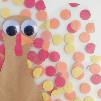 This fine motor turkey kids craft is fun for all ages! This Thanksgiving day craft is fun to create and adds a cute flare to your windows or fridge for the season.  Great craft to keep the kids busy while mom is busy cooking.