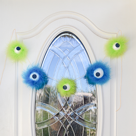 A furry, not-too-spooky monster eyeball Halloween garland.