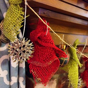 DIY Christmas Garland. Simple rustic and natural garland made from sweetgum balls, inexpensive Christmas ornaments, and burlap.