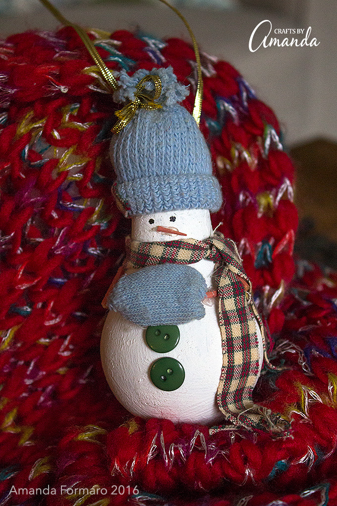 I'm loving this cute little snowman, and I know you have light bulbs lying around to make one!
