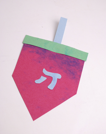 A festive dreidel card for Hanukkah