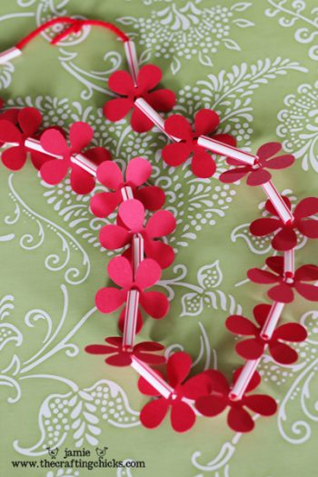 Turn paper and straws into a fun Hawaiian lei!
