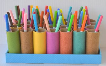This cute organizer is made from an empty box and cardboard tubes!