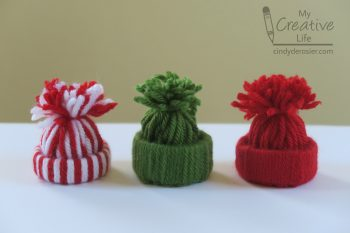 Cute ornaments made from just yarn and a cardboard tube!