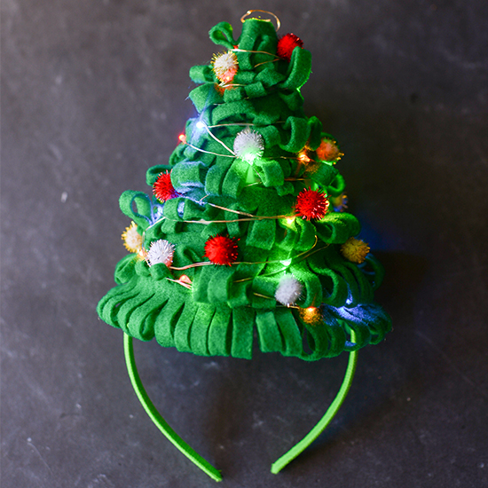 The ultimate Ugly Christmas Sweater Party accessory--a Christmas tree hat that lights up!