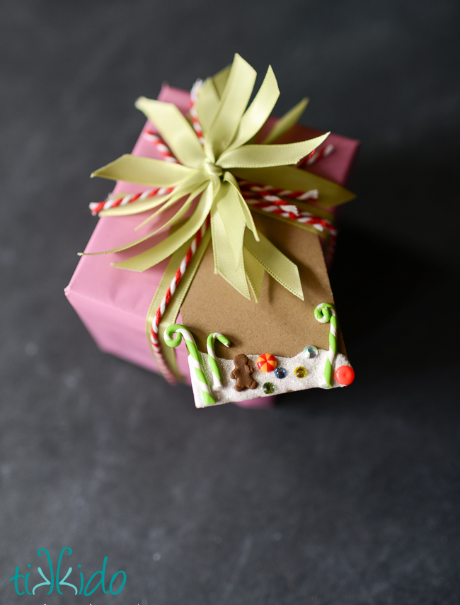 Use polymer clay, beads, rhinestones, and puff paint to make a Christmas Candyland gift tag.