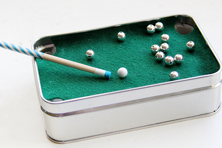 A travel-sized pool table in an Altoids tin!