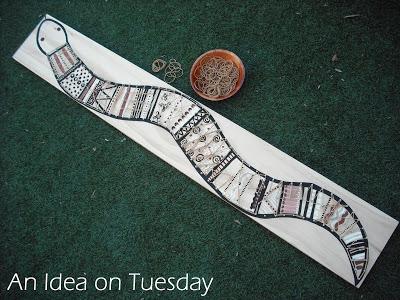 A geoboard shaped like a snake